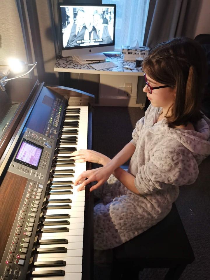 cara in a piano lesson