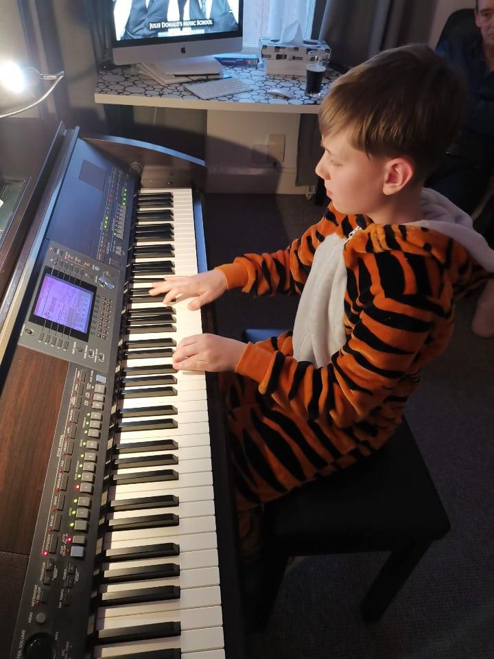 freddie in a piano lesson