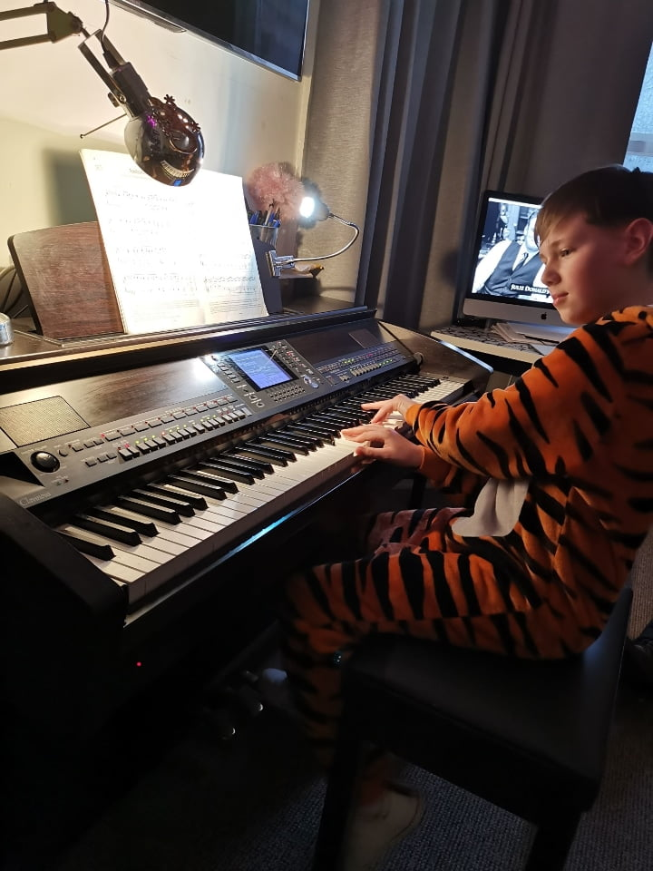 freddie still playing the piano